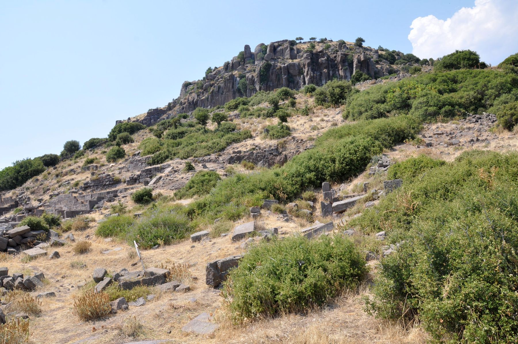 Ruins of Assos on the slope facing the sea