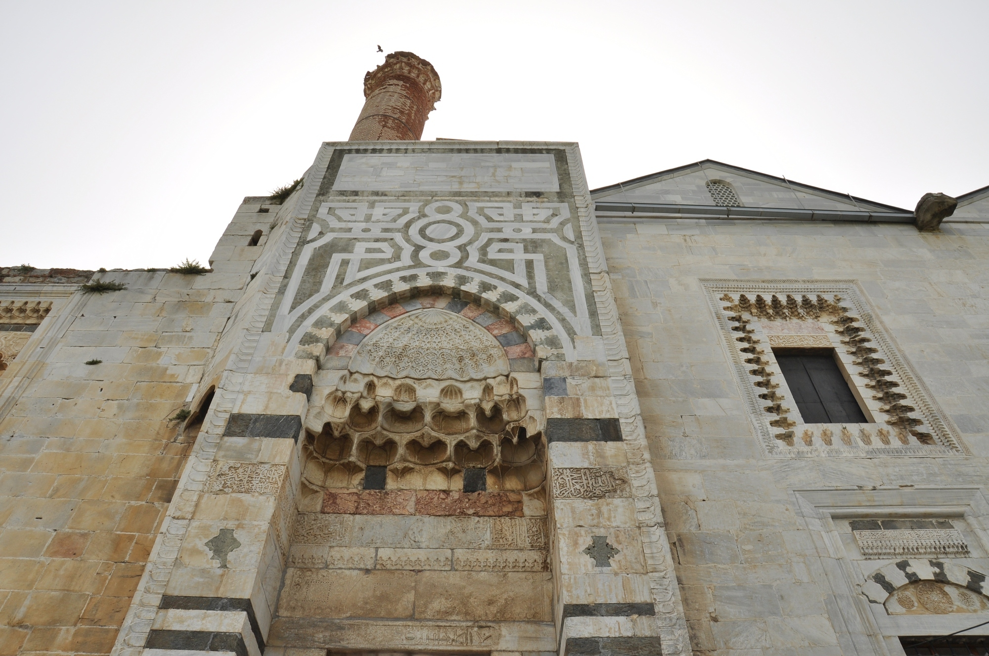 Reconstructed western portal of İsa Bey Mosque