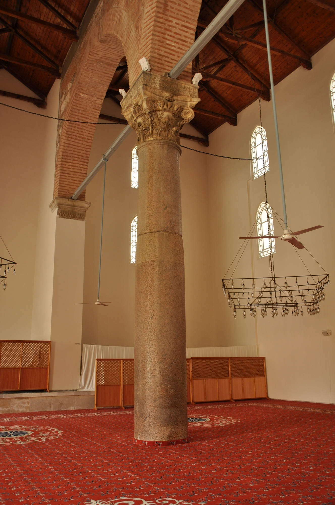 Massive column with the capital of the Composite order in İsa Bey Mosque