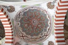 Üç Şerefeli Mosque - frescoes in the courtyard
