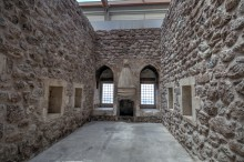 Ishak Pasha Palace - a room with a fireplace